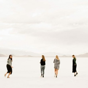Four women walking in Bonneville Salt Flats