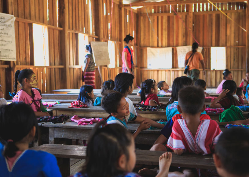A school class with little girls and teachers in Myanmar (Burma).