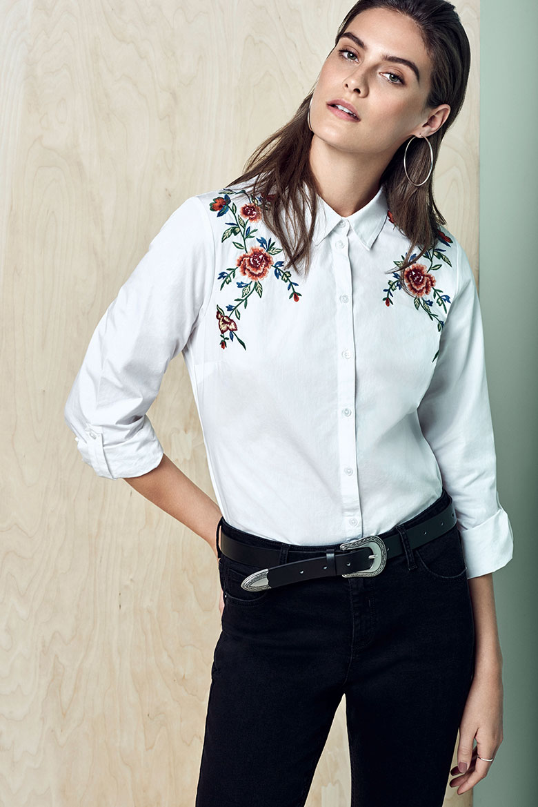 A white shirt with embroidery looks great with black denim pants. A little Western romance flair to the whole outfit. Image by Dorothy Perkins.