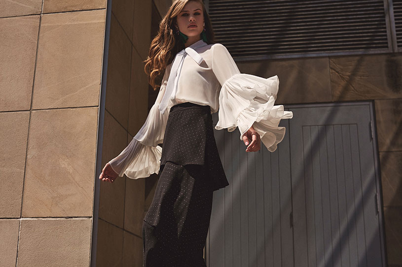 This is one serious style statement white shirt with fluffs on the sleeves. Combined with a black long skirt with fluffs, looking gorgeous. Image by Girls on Film.