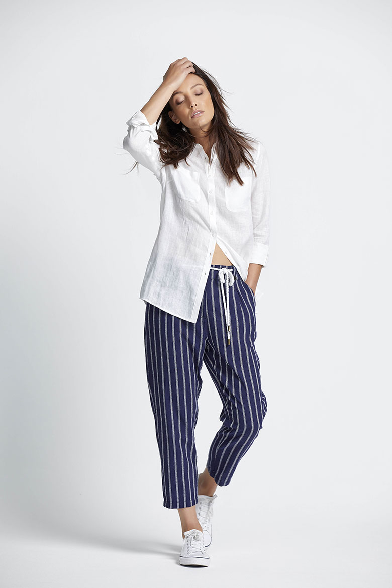 A white linen classic shirt always looks good, especially when combined with blue and white stripe pants. Image by M&Co.