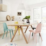 Dining chairs can always add splashes of color in a neutral color kitchen like this one. Image by Nest.co.uk.
