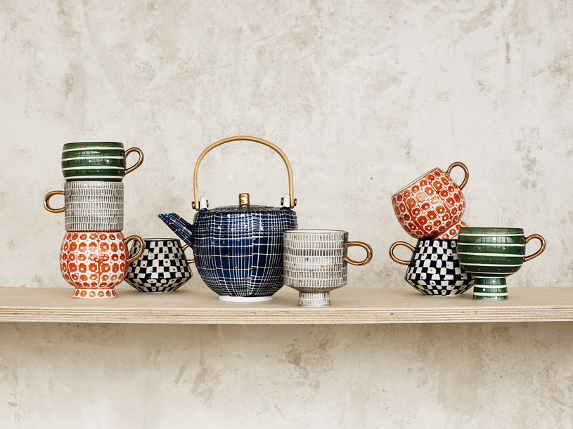 Are these mugs with a geometric pattern on them beautiful or what. And the blue tea pot among them looks so precious. Image by Oliver Bonas.