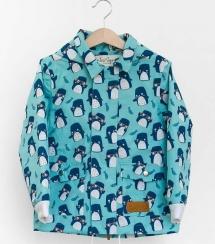 A child's blue raincoat with a penguin print