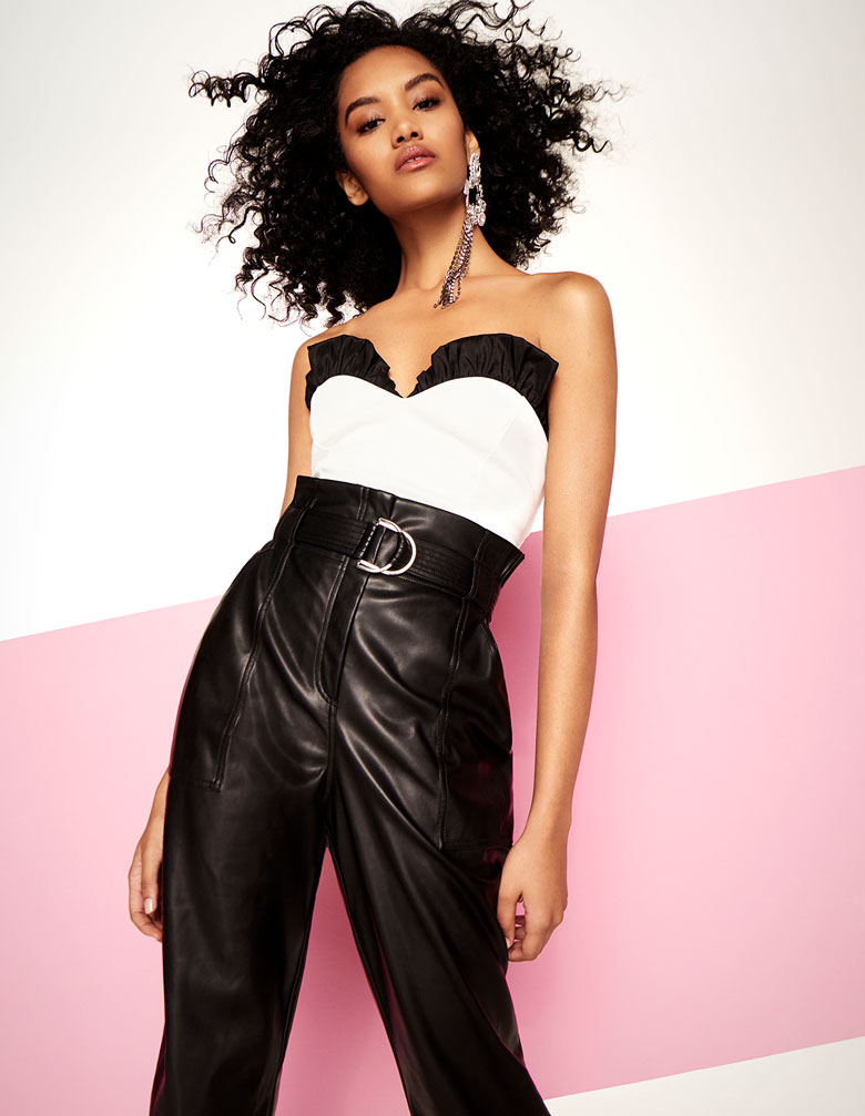 High waisted leather pants with a black and white strapless top always looks hot, as worn by model. Image by River Island.