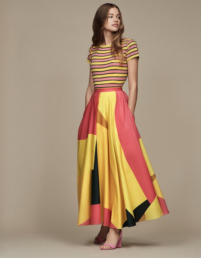Give me stripes atop and a long skirt with assymetric patterns and you get a statement outfit like this one a young model wears. Image by Debenhams.
