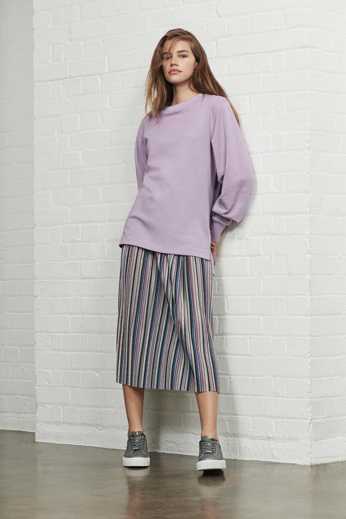 A striped long skirt paired with a color coordinated sweat top looks awesome on this young girl model. Image by Debenhams.