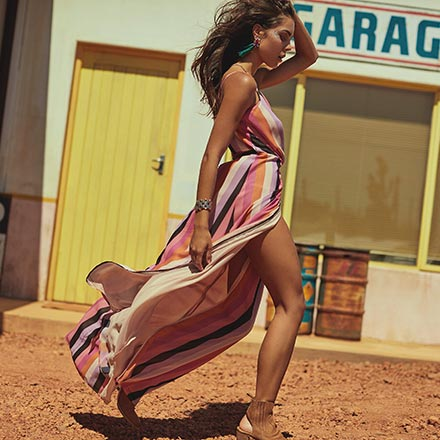 A fab wrap dress with spaghetti straps and vertical stripes, looking sexy on this model. Image by Girls on Film.