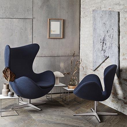 A blue Fritz Hansen Egg chair in a concrete grey nook. Talk about design envy.