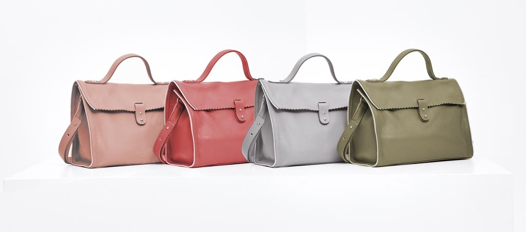 Four soft leather RIEN bags in various colors.