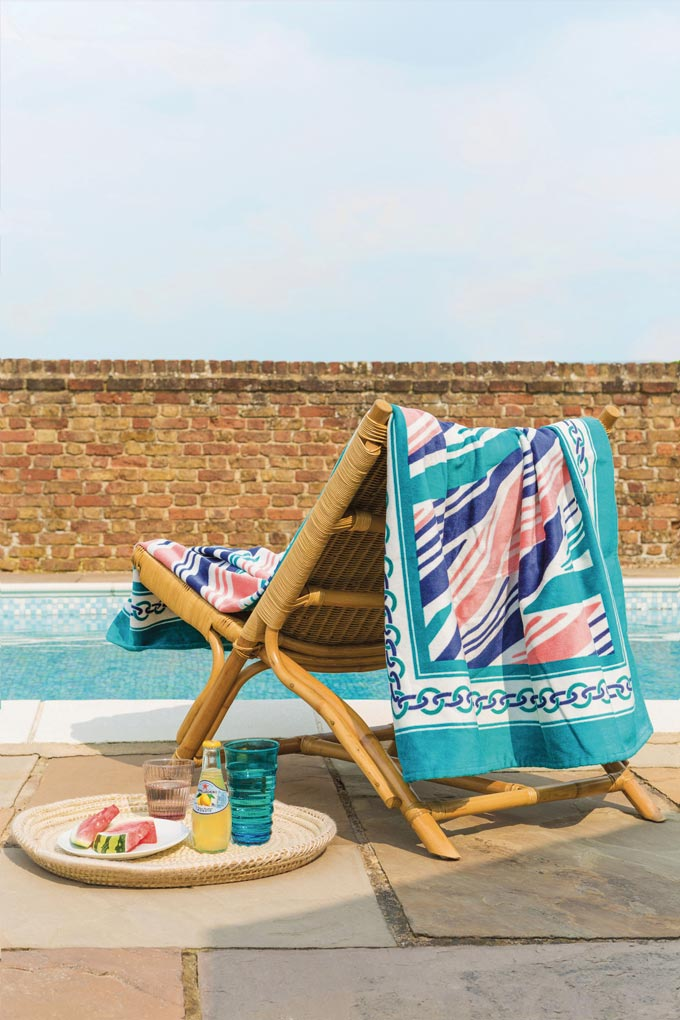A beautiful beach towel on a beach chair by a pool. How relaxing is that?! Image by Amara.