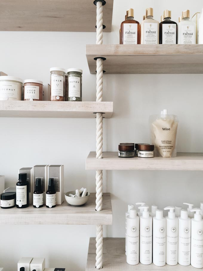 Shelves with cosmetic products lined up with a very organic flair to them.