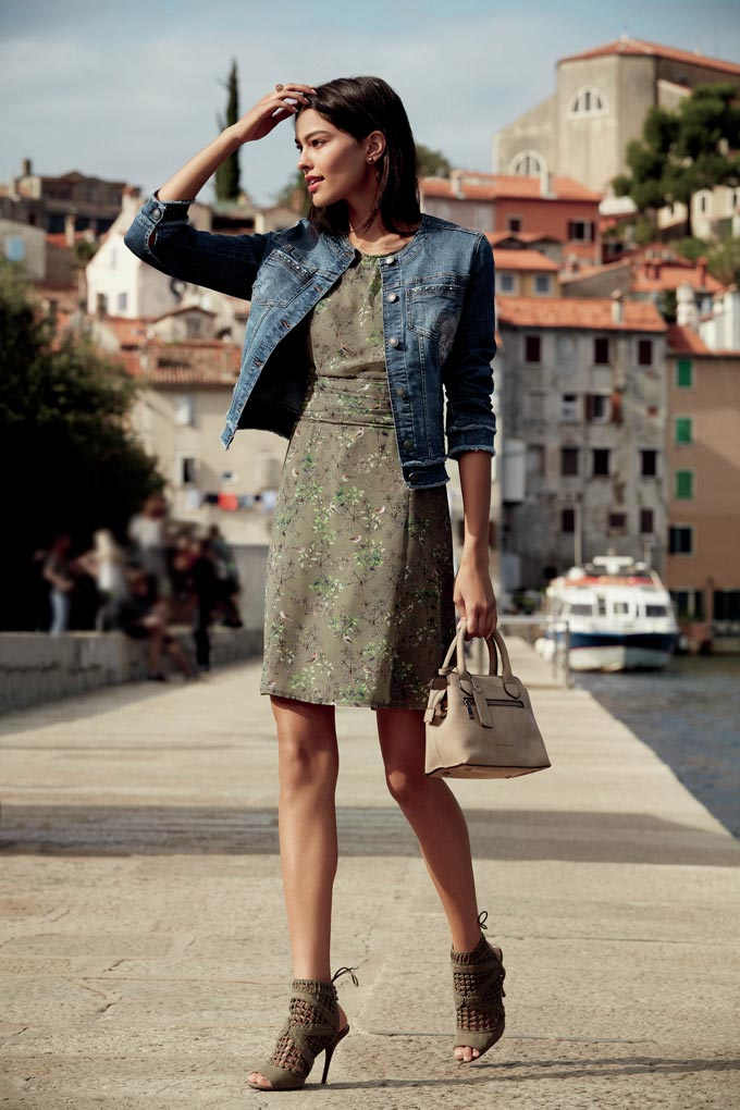 A denim jacket (low key element) paired with a dress and statement shoes in a sage green color (both high key elements). Image by Betty Barclay.