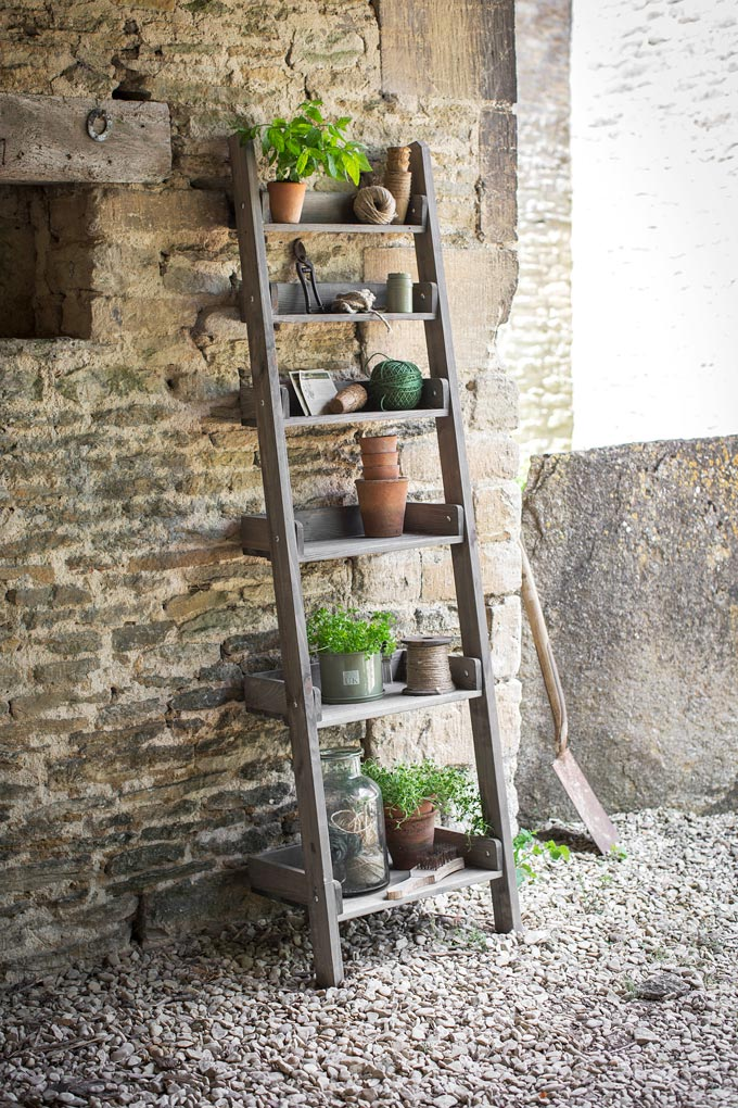 I just love this rustic pot-holding rustic ladder against the brick accent wall. It's just perfect for holding a lot of plants in one spot. Image by Cuckooland.