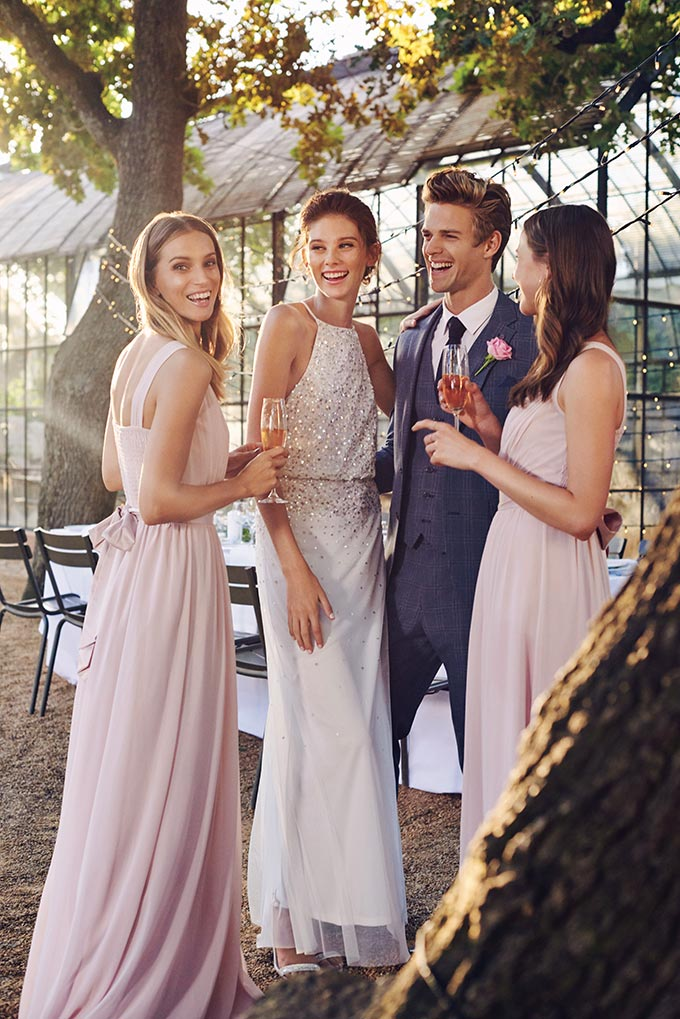 A wedding couple with two friends at an outdoor reception, all looking stylish and posh dressed in Dorothy Perkins. Image by Dorothy Perkins.