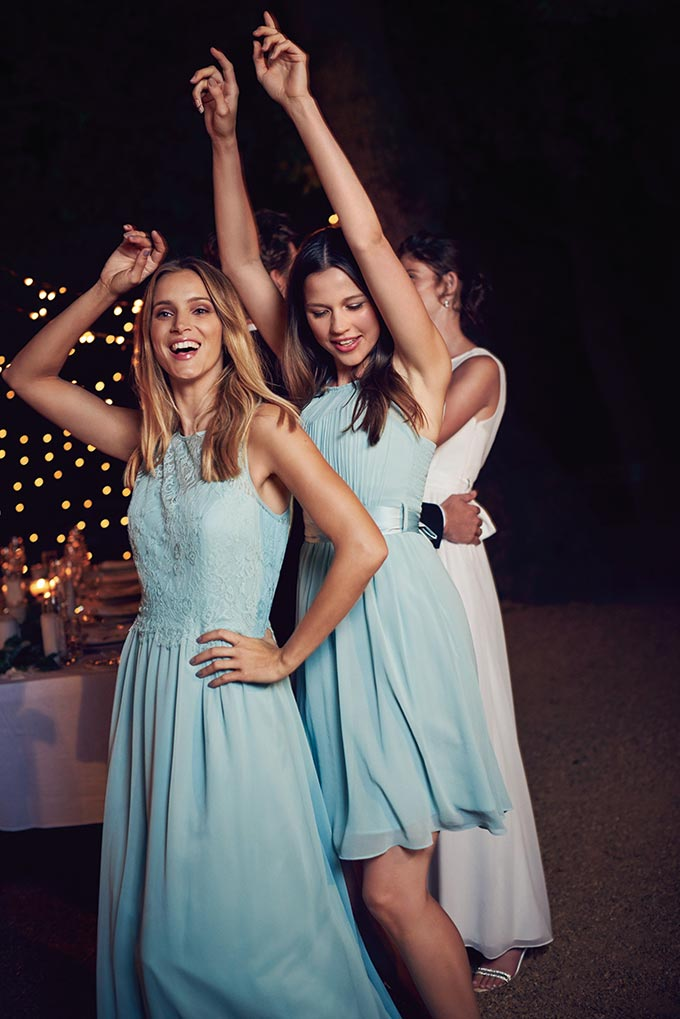 Three girls dancing at an outdoor wedding reception, looking good. Image by Dorothy Perkins.
