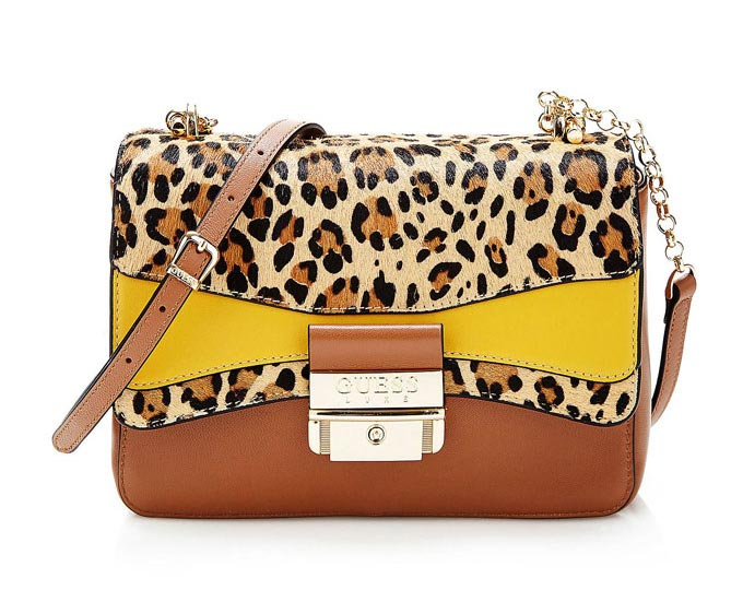 A trendy women's small shoulder bag by GUESS, with a leopard print, a yellow block and a tan leather combo. Image by Guess Jeans.