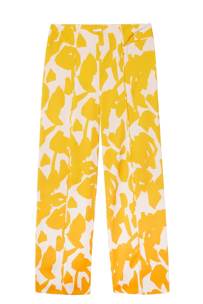 A pair of pants with a vibrant yellow flower print. Image by House of Fraser.