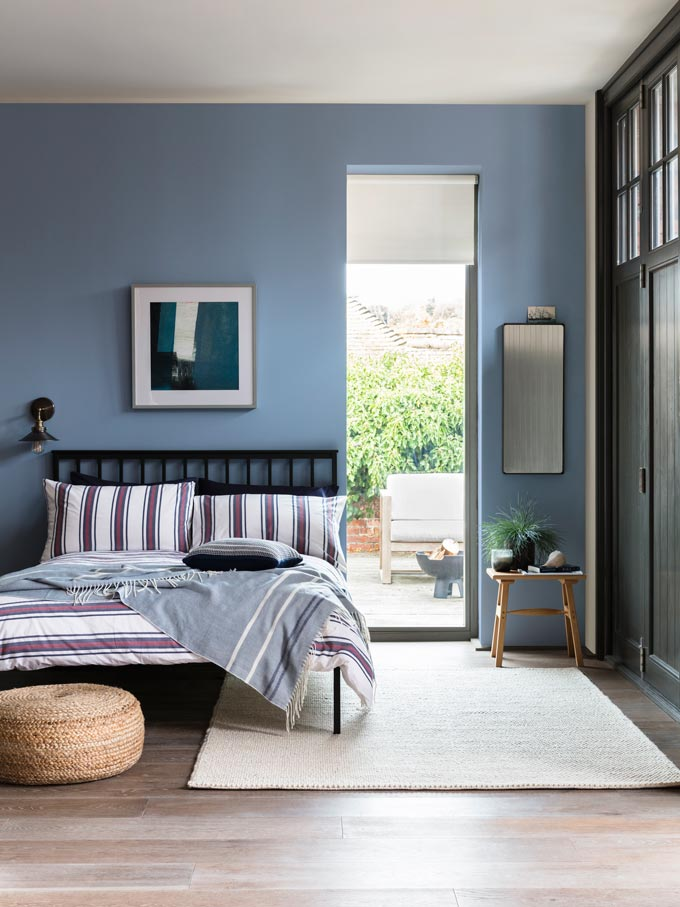 A blue bedroom with a nautical flair to it. How calming! Image by John Lewis.