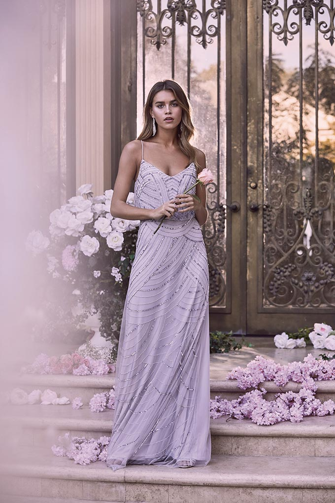 A maxi silver all over sequin cami dress. Image by Lipsy.