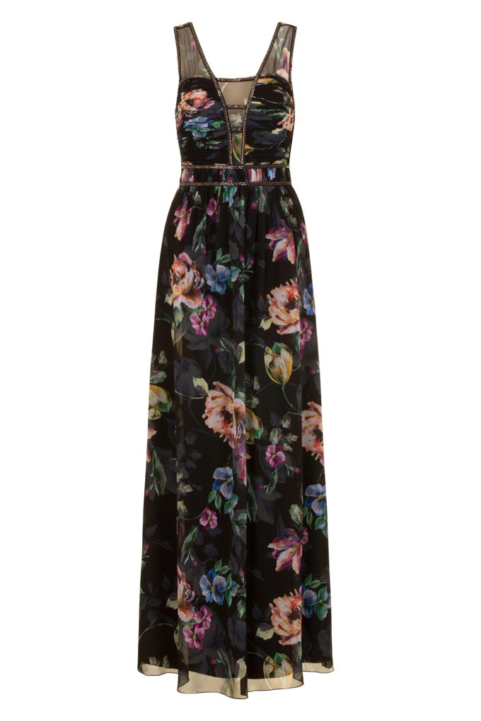 A black maxi dress with a flower print. Image by Little Mistress.