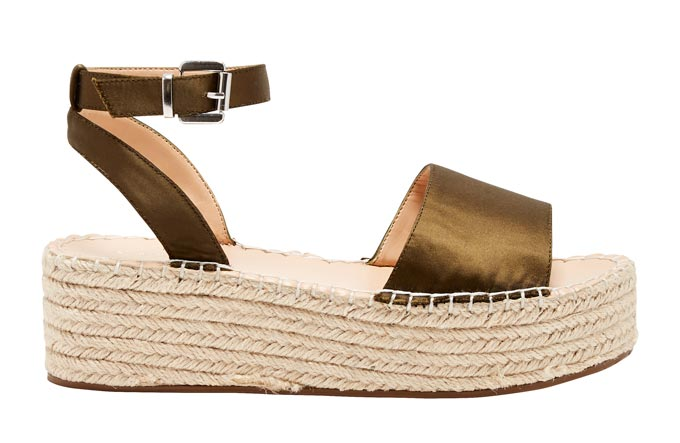 This is the ideal shoe to walk around the stone paved alleys of Greek islands. A flat platform shoe with a dark goldish like strap. Image by Matalan.