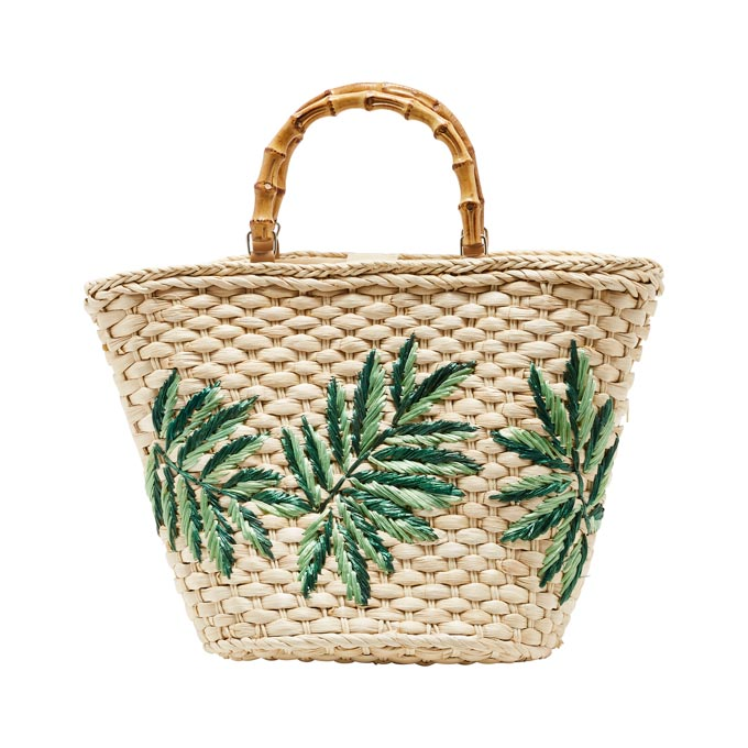 A straw beach bag with a tropical theme. Image by Matalan.