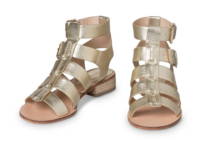 A pair of goldish gladiator like flat sandals. Image by Oliver Bonas.