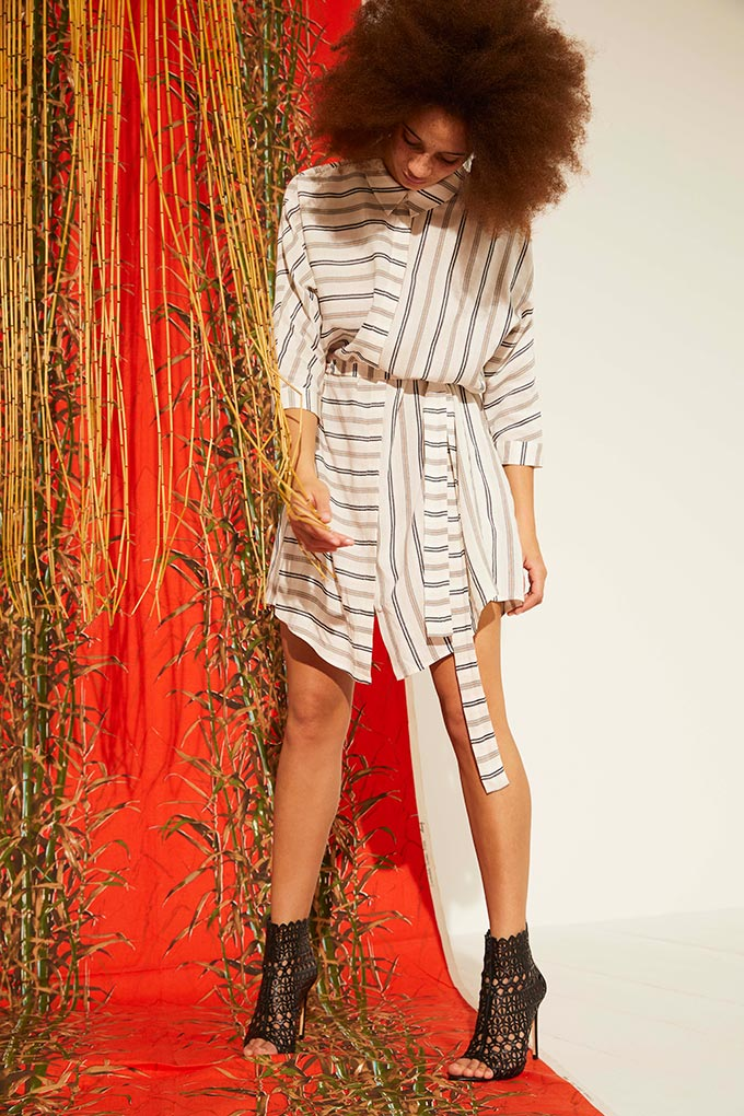 How stylish is this shirt dress paired with those ankle booties. Image by Oliver Bonas.