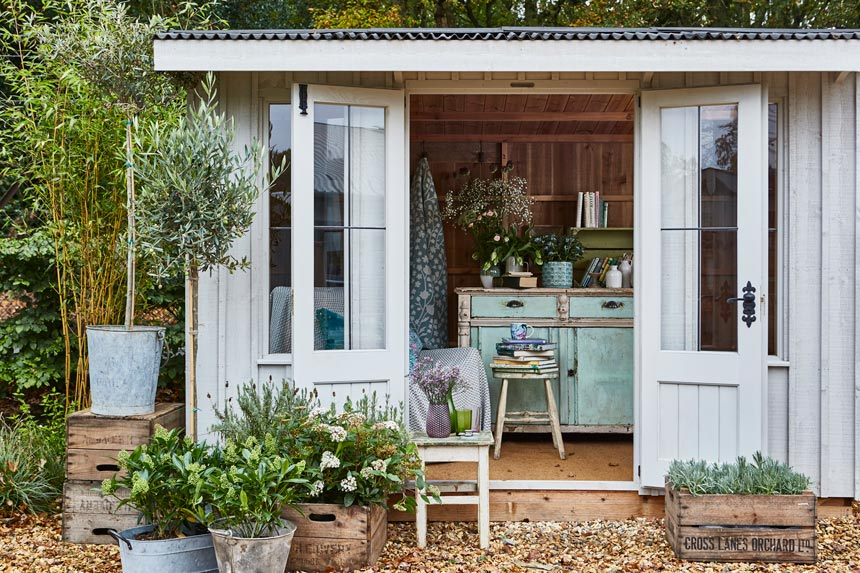 A garden shed with a vintage look and plenty of plants in beautiful pots looks gorgeous. Image by National Trust.