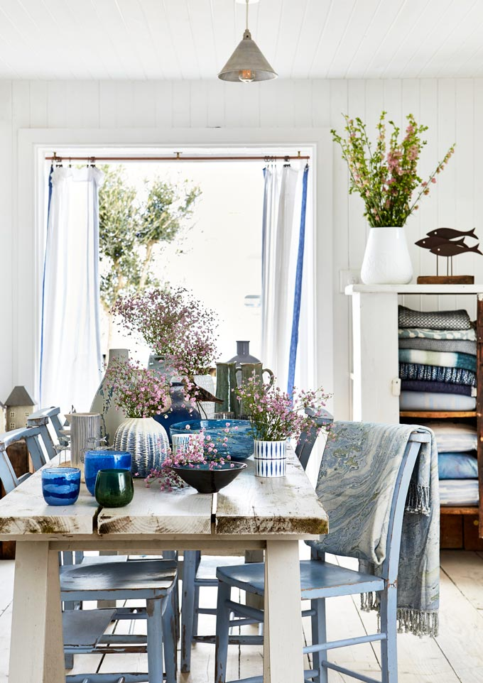 How beautiful is this dining interior?! All white but with so many blue accents from dinnerware to soft textiles and some greenery to bring life to it all. Image by National Trust.