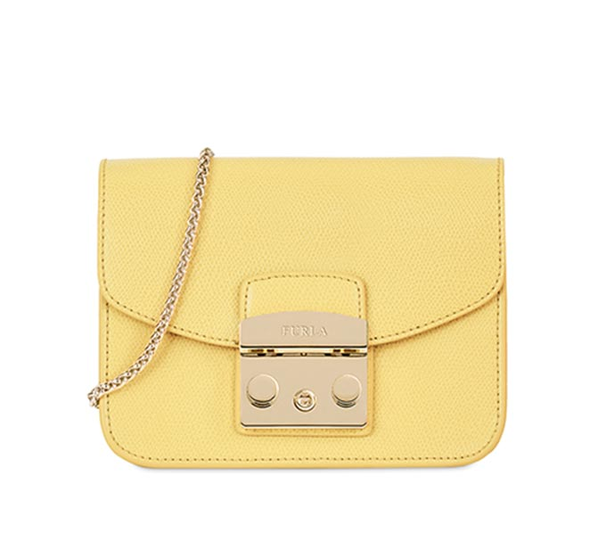 A mini Furla bag with a chain shoulder strap. Image by Very Exclusive.