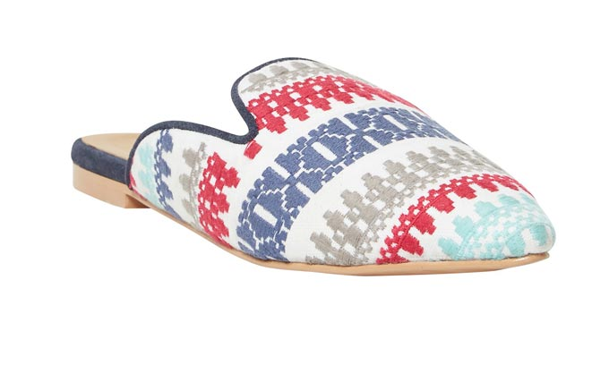 A flat mule with a pattern print on it can surely look good with an all white outfit. Image by Whitestuff.