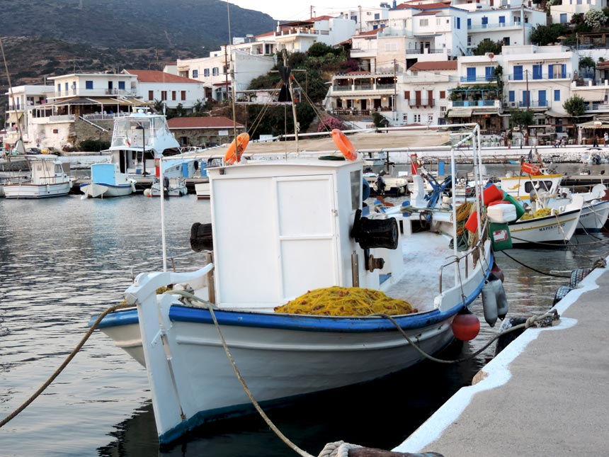 Partial view of the Batsi seaside village and its marina with its fishing boats.