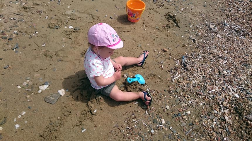 My daughter playing at beach of Batsi. Image by Velvet.