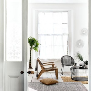 Sneak view of a minimal Scandi looking sitting set in a bright white room. I just love both armchairs with their textured feel and the black round coffee table in front of them. Image by Debenhams.