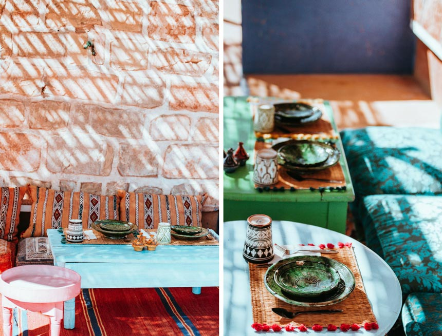 Left image of a low table setting for dining outdoors. The bench is filled with patterned pillows and the rugs on floor are bright red with patterns too. Right image of another outdoor low dining setup in bright and earthly colors.