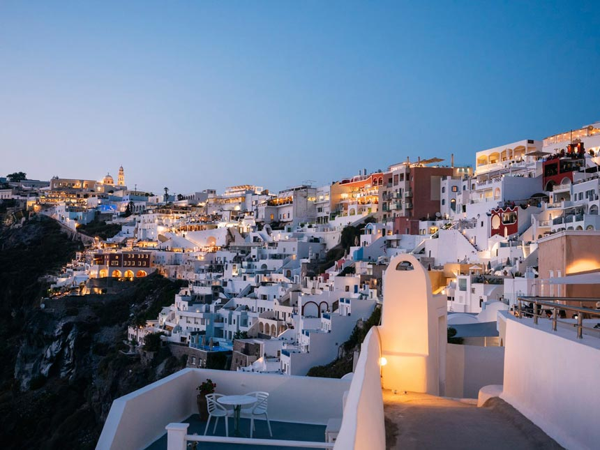 Homes on the cliffs of Oia in Santorini after sunset.