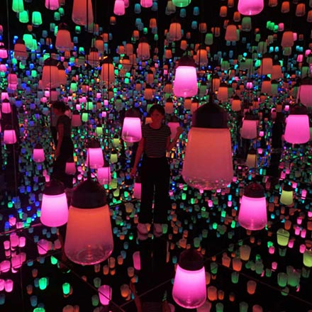 Elizabetta Rizzato standing in the Forest of Lamps exhibition installation at the first Digital Art Museum in Tokyo. Image copyright: Italianbark.
