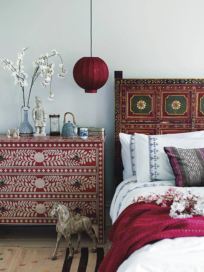 A bohemian style bedroom. The chest next to the headboard is a priceless combination. Image by HomeSense.