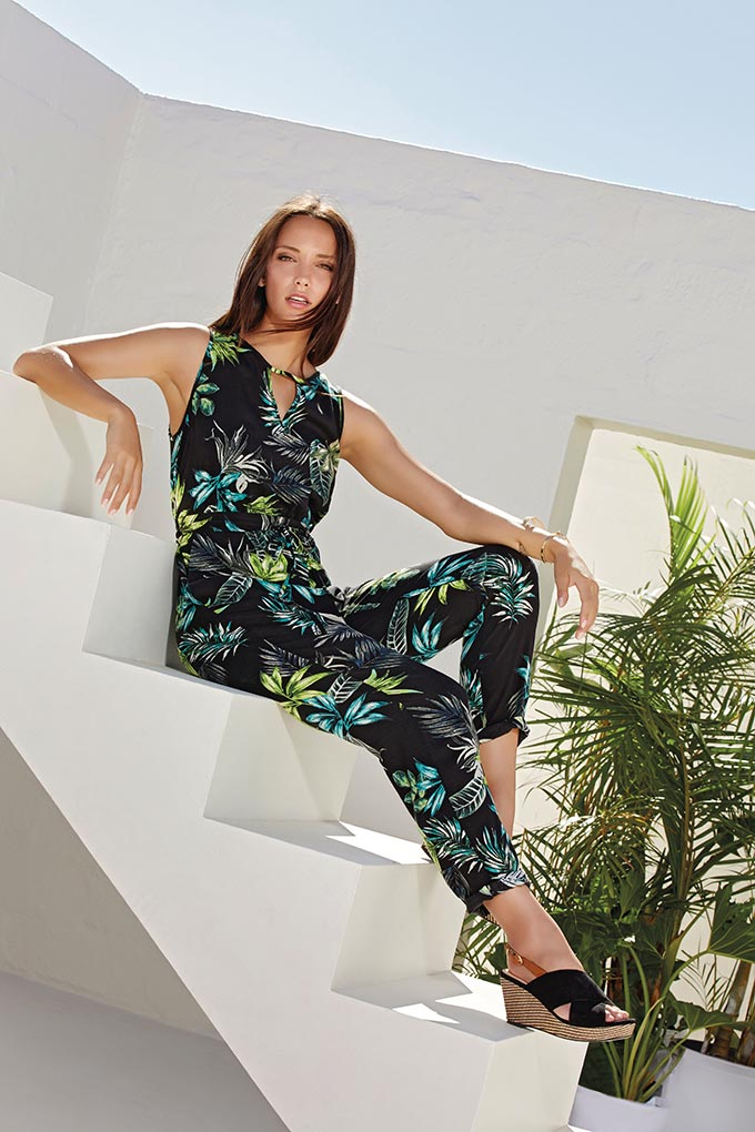 A beautiful jumpsuit with a tropical print looks so exotic on this model. Image by M&Co.
