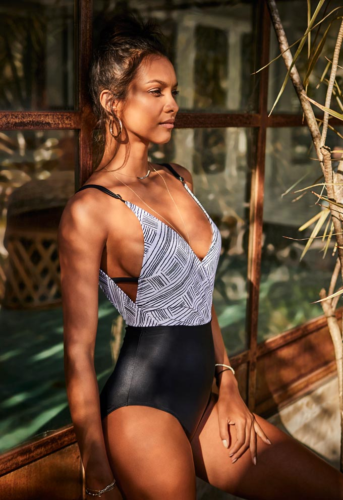 A beautiful one piece swimsuit looking sexy on a beautiful brunette. Image by Matalan.