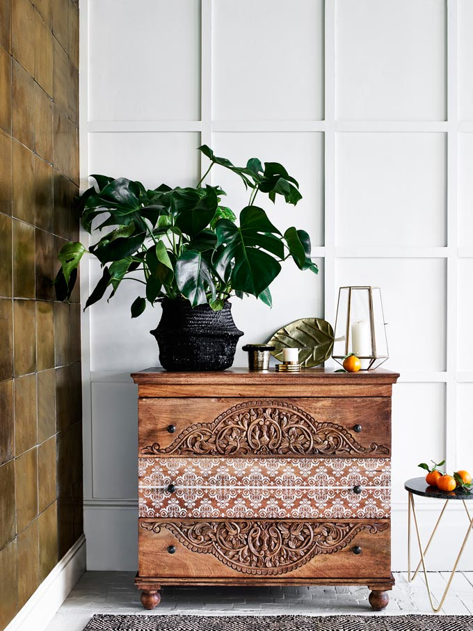 How gorgeous is that patterned chest?! A big leaf plant atop and some decor and you get a nice stylish vignette. Image by Monsoon.