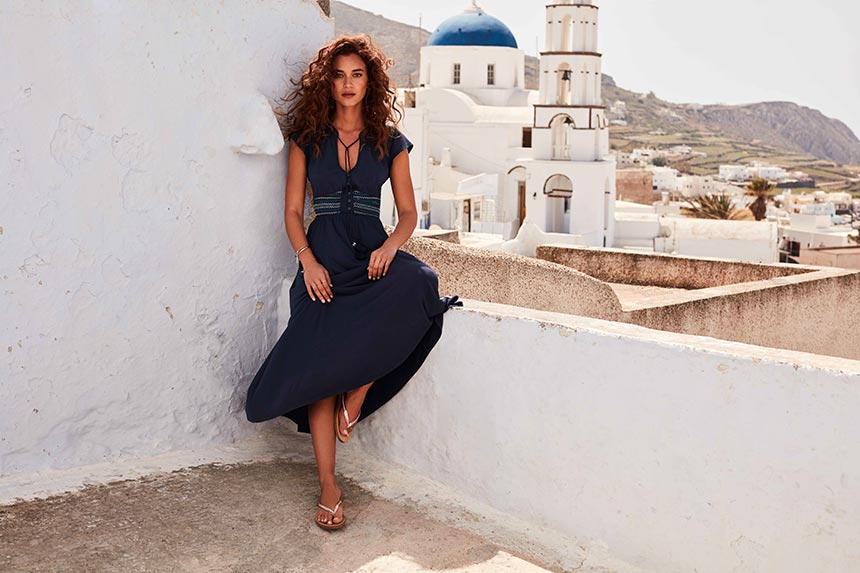 I love this black boho style dress with long wavy hair. It looks so gorgeous against the white background of Santorini's homes and churches. Image by Monsoon/Accessorize.
