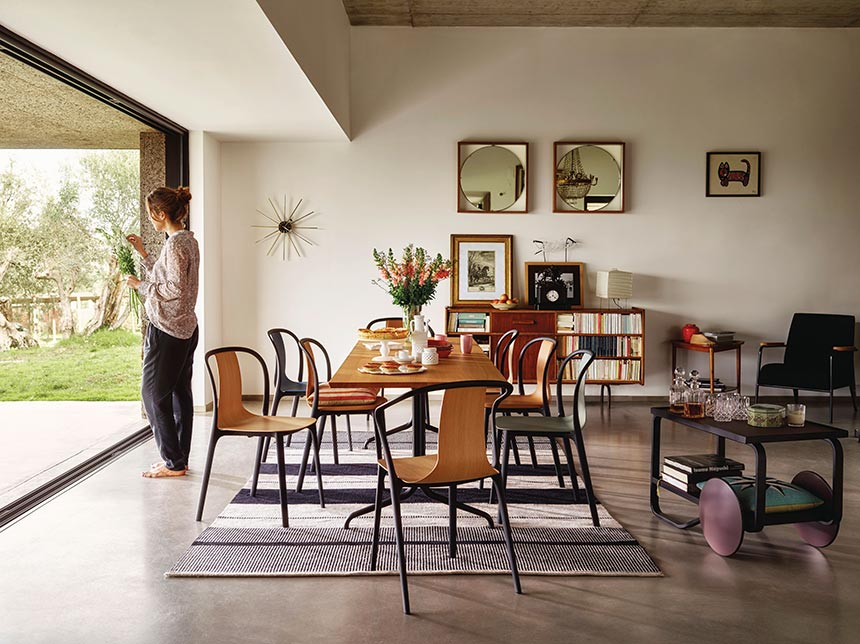 A contemporary modern dining setting with lots of Belleville armchairs designed by the brothers Ronan and Erwan Bouroullec. Image by Nest.co.uk.