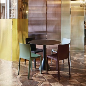 A dining setting with the Hay Elementaire Chair designed by the Bouroullec brothers. Image by Nest.co.uk.