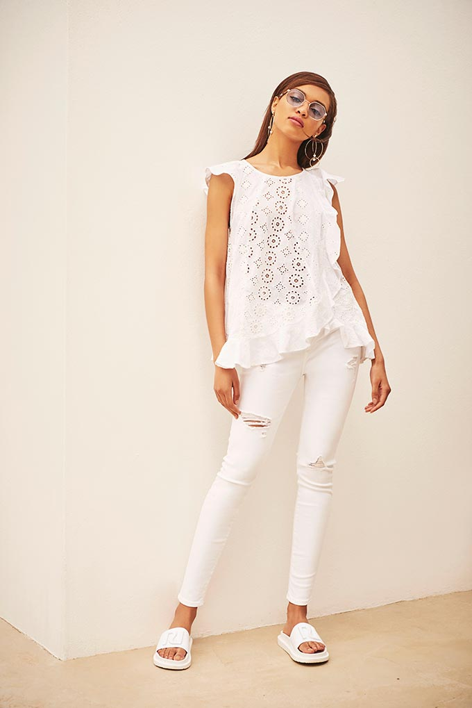 Love the all white outfit - top, pants, sliders. So summery and perfect for an outing in a Greek island. Image by River Island.