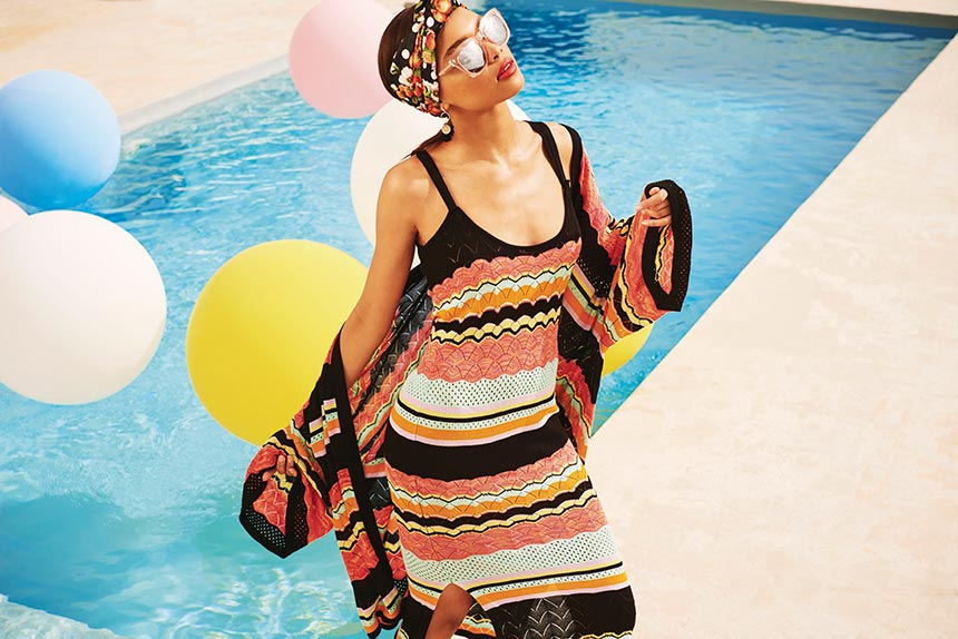 That must be this summer's coolest knitdress paired with coordinating cardigan, as worn by model. It reminds me of Missoni's chevron patterns. Image by River Island.