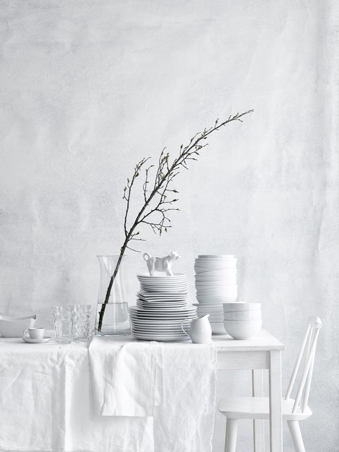 Are you feeling the white impact? An all white setting with dining table, chair, dinnerware, tablecloth and all including a white background.