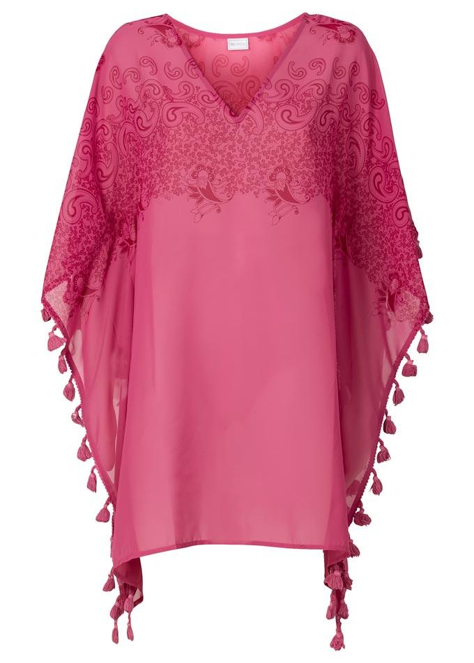 A dark pink kaftan with pom poms. Image by Swimwear365.